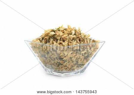 dry acacia in glass wares on a white background