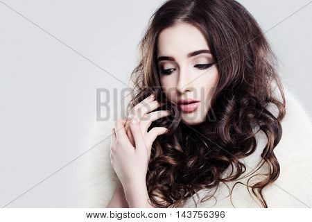 Pretty Lady. Makeup and Curly Hair on gray