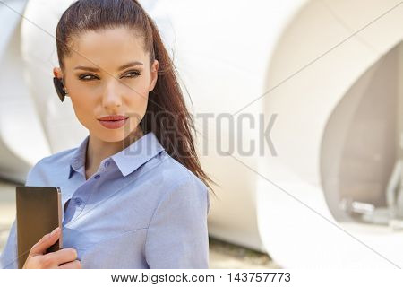Smiling businesswoman using electronic gadget