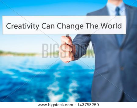 Creativity Can Change The World - Business Man Showing Sign