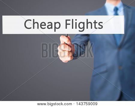 Cheap Flights - Business Man Showing Sign