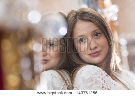 Young woman and dressing room mirror