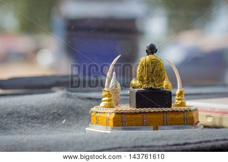 Budha sit on a pedestal in the car.