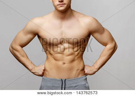 Studio shot of Handsome young man's torso