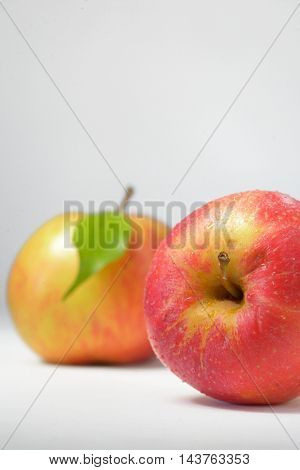 closeup isolated red apple and drops