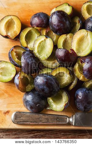 Ripe Plums Scattered On A Brown Wooden Background. Bio Healthy F