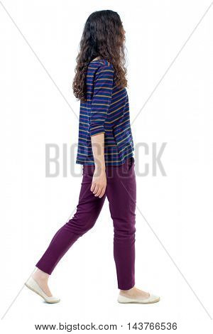 back view of walking  curly woman.  backside view of person.  Rear view people collection. Isolated over white background. Long-haired curly girl goes past the camera.