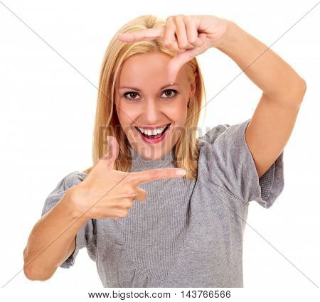 happy young woman creating a frame with her fingers, isolated on white background