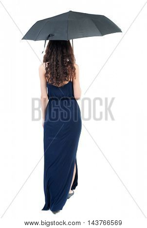 young woman in dress walking under an umbrella. Rear view people collection.  backside view of person.  Isolated over white background. The dark curly girl in blue evening dress goes under an umbrella