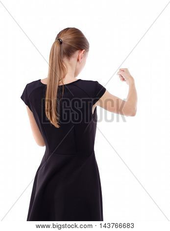 skinny woman funny fights waving his arms and legs. Isolated over white background. Blonde in a short black dress put his fists in front of him.