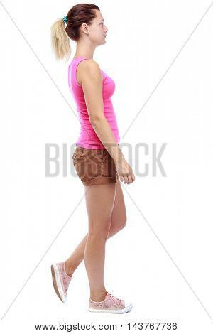 back view of walking woman . going gir in motion. Rear view people collection.  backside view of person. Isolated over white background. Sport blond in brown shorts sadly passes.