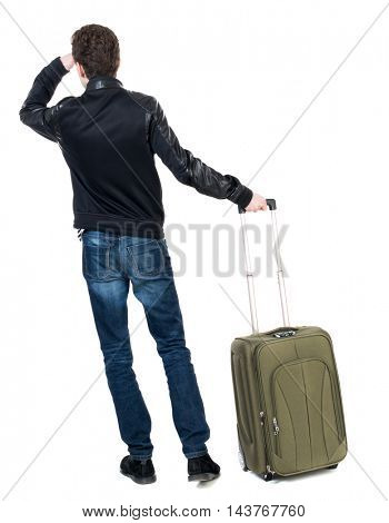 Back view of man with  green suitcase looking up. Rear view people collection.  backside view of person.  Isolated over white background. Curly short-haired guy in a black jacket standing with green