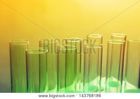 Test tubes on light yellow background