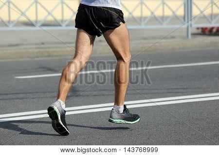 feet running athlete at the distance of a marathon