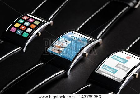modern technology, object and media concept - close up of black smart watch set with business news, messenger application and menu icons