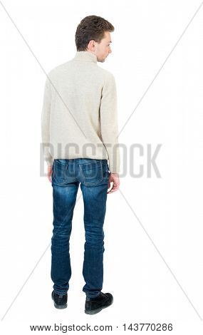 Back view of man . Standing young guy. Rear view people collection.  backside view of person.  Isolated over white background. Curly short-haired man in a woolen white jacket looking sideways.