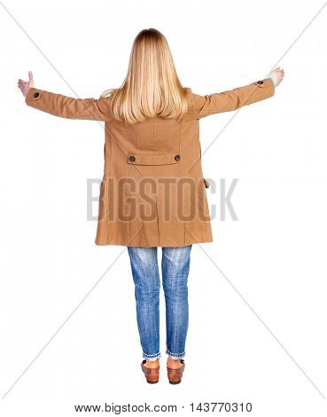 Back view of beautiful woman welcomes. Young teenager girl in jeans hand waving from. Rear view  people collection.  backside view of person.  Isolated over white background. The blonde in a brown