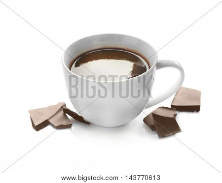 Cup of hot chocolate and pieces, isolated on white