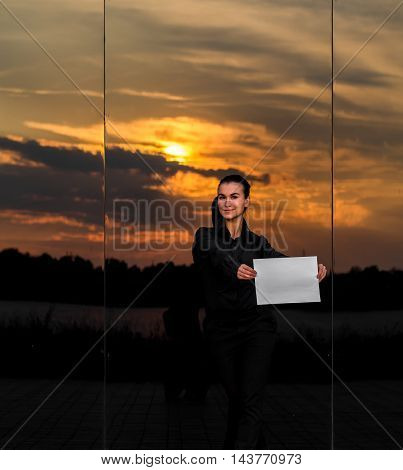 Beautiful Business Girl With White Piece Of Paper