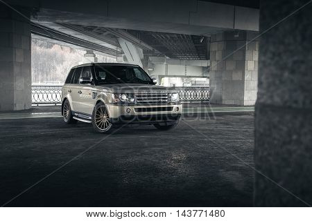 Moscow, Russia - November 22, 2015: Car Land Rover Range Rover stand under bridge in Moscow city at daytime