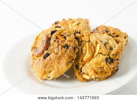 homemade almond cookies on white plate with white background