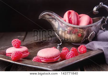 Traditional French Sweets. Macaroon With Raspberries In A Vintag