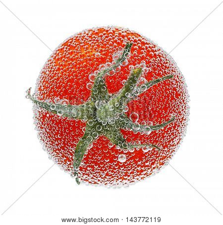 Tomato in a water on white background