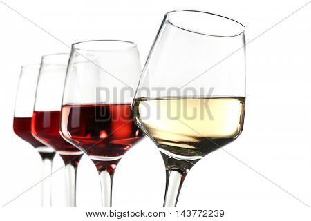 Glasses with different wine in a row, isolated on white