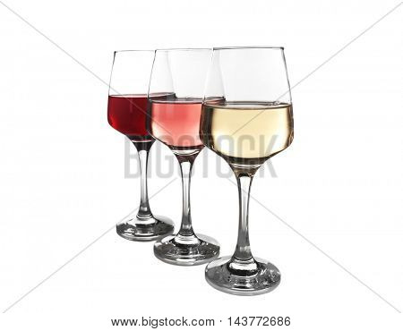 Glasses of rose, red and white wine isolated on white