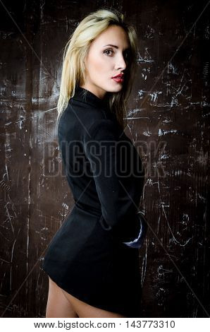 Cute blond  woman wearing a jacket over her naked body