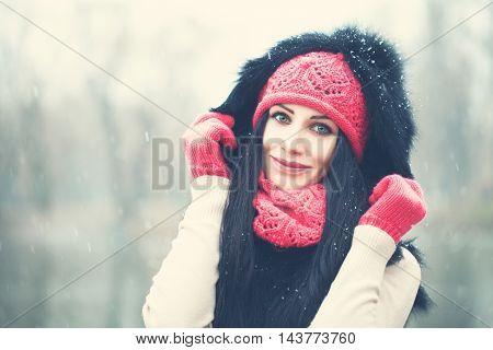 Winter Girl Outdoors. Portrait of Happy Woman