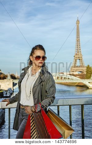 Fashion-monger With Shopping Bags In Paris, France Looking Aside