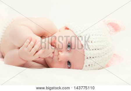 portrait of femail newborn with bunny woolen hat