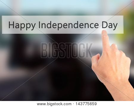 Happy Independence Day - Hand Pressing A Button On Blurred Background Concept On Visual Screen.