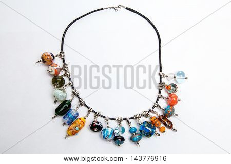 Hand made jewelry with glass beads on white background