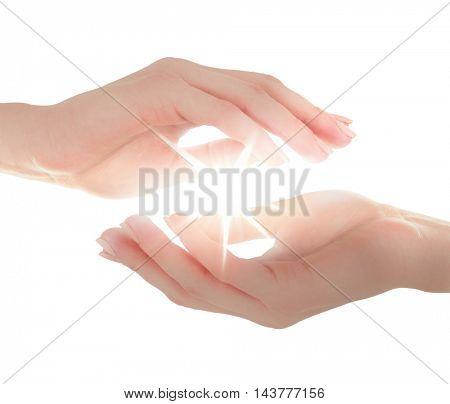 Female hands holding light on white background.