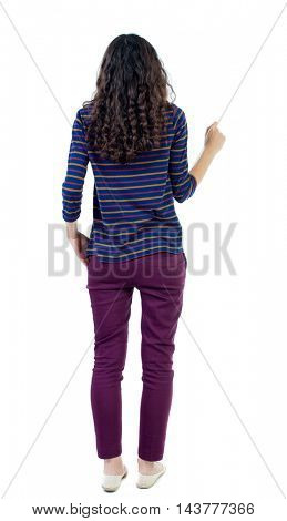 back view of standing young beautiful  woman.  girl  watching. Rear view people collection.  backside view of person. Long-haired curly girl in a blue striped jacket presses squeezed his hand into a