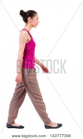 back view of walking  curly woman.  backside view of person.  Rear view people collection. Isolated over white background. dark girl goes past the camera