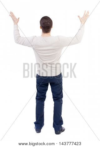 Businessman defends his hands on top of something. backside view of person.  Isolated over white background. The bearded man in a white warm sweater in horror spread his arms.