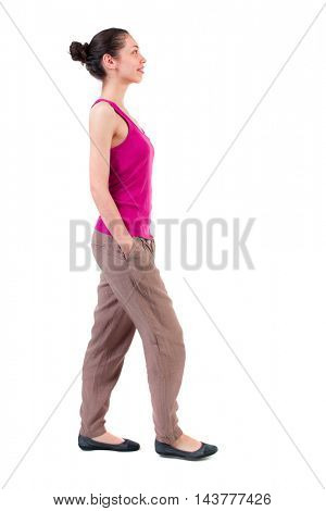 back view of walking  curly woman.  backside view of person.  Rear view people collection. Isolated over white background. dark-skinned girl is smiling and looking up.
