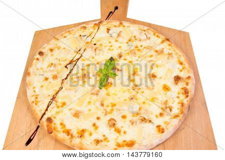 hot pizza with pineapple and basil isolated on white background