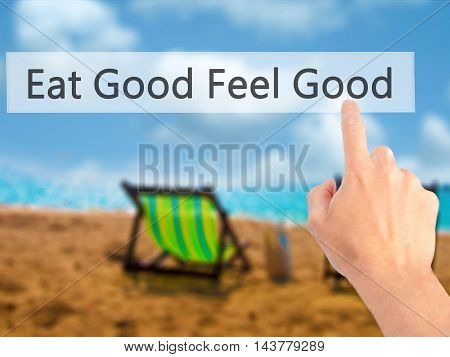 Eat Good Feel Good - Hand Pressing A Button On Blurred Background Concept On Visual Screen.