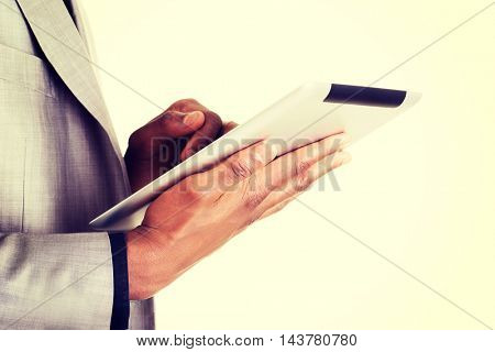 Handsome businessman with tablet