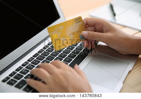 Woman hands using credit card and laptop for online shopping