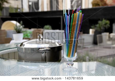 Colorful drinking straws in glass on the bar at the resort resting area