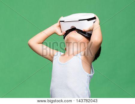 Little boy watching though virtual reality