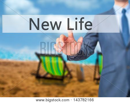 New Life -  Businessman Press On Digital Screen.