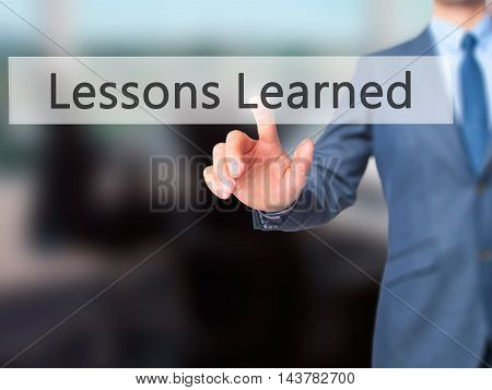 Lessons Learned -  Businessman Press On Digital Screen.