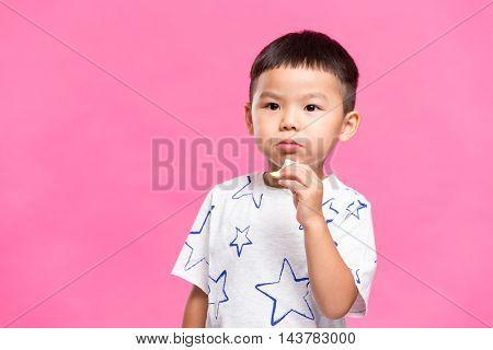 Little boy eating snack