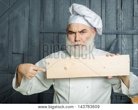 Bearded Cook With Wooden Plate
